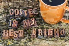 Coffee is my best friend attitude letterpress. Coffee caffeine break time is my best friend letterpress letters words positive stress reducer relax Royalty Free Stock Photo