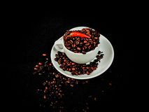 Coffee caffeine cafe beans brown aroma. Ceramic whitecup redpepper pepper Stock Images