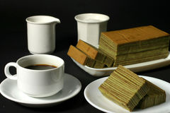 Coffee & cake. Coffee time with Idonesian spiced layered cake Royalty Free Stock Images