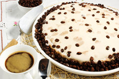Coffee cake. On tablecloth and the cup Royalty Free Stock Photos