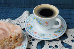Coffee and cake. Cup of coffee and biscuit cake on white knitting cloth Royalty Free Stock Photos