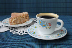 Coffee and cake. Cup of coffee and biscuit cake on blue background Royalty Free Stock Images