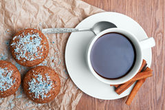 Coffee and cake. Black coffee with fresh cupcakes Stock Images