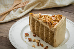Coffee cake with almonds on plate Stock Photo