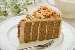 Coffee cake with almonds on plate Royalty Free Stock Images