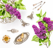 Coffee cake antique silver dishes Lilac flowers Flat lay Royalty Free Stock Photography