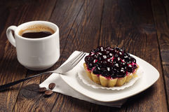 Coffee and cake with black currants Stock Image