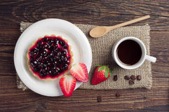 Coffee, cake with black currants and strawberry Stock Images