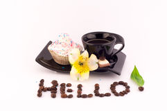 Coffee, Cake and Flowers. Coffee and cake with cream,chocolad and fresh flowers on a white background and lettering Hello royalty free stock images