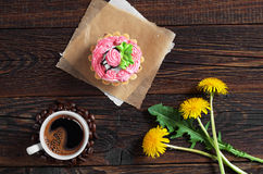 Coffee, cake and flowers Stock Images
