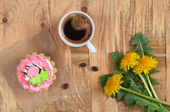 Coffee, cake and flowers Stock Photos
