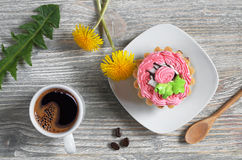 Coffee, cake and flowers Stock Image