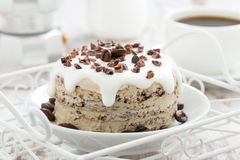 Coffee cake with icing decorated with cocoa beans Stock Photography