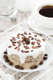 Coffee cake with icing decorated with cocoa beans, top view Royalty Free Stock Image