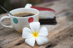 Coffee and cake. Leelavadee & x28;Plumeria& x29; tropical flower have white cup coffee background Stock Photo