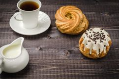 Coffee with cake and milk/ breakfast: coffee with cake and milk on a dark wooden background. Copy space. Coffee with cake and milk/breakfast: coffee with cake royalty free stock photos