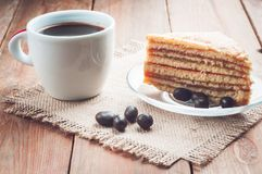 Coffee, cake and peanuts on the wood background Stock Photo