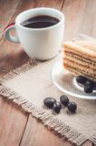 Coffee, cake and peanuts on the wood background Royalty Free Stock Images