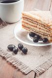 Coffee, cake and peanuts on the wood background Royalty Free Stock Photography