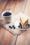 Coffee, cake and peanuts on the wood background Stock Photography