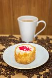 Coffee and cake on a plate. Coffee in a white mug and cake plate royalty free stock image