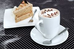 Coffee and cake on polka dot table Royalty Free Stock Images