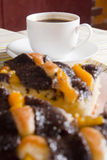 Coffee and cake with poppy seeds and orange Royalty Free Stock Images