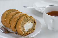 Coffee Cake Roll with a Cup of Tea. Coffee cake roll with a cup of tea on tea breaking time Royalty Free Stock Image