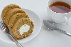 Coffee Cake Roll with a Cup of Tea. Coffee cake roll with a cup of tea on tea breaking time Stock Photography
