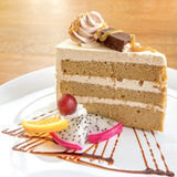 Coffee cake serve with fresh fruit. On wooden table Royalty Free Stock Photos