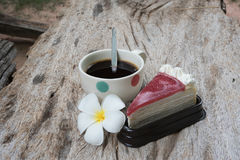 Coffee and cake. Strawberry cake  Coffee cup and Frangipani Flower on the wooden table Royalty Free Stock Photos