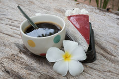 Coffee and cake. Strawberry cake  Coffee cup and Frangipani Flower on the wooden table Stock Images