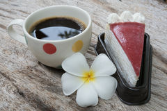 Coffee and cake. Strawberry cake  Coffee cup and Frangipani Flower on the wooden table Stock Image