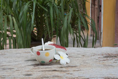 Coffee and cake. Strawberry cake  Coffee cup and Frangipani Flower on the wooden table Stock Photo