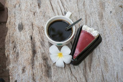 Coffee and cake. Strawberry cake  Coffee cup and Frangipani Flower on the wooden table Stock Photography