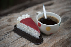 Coffee and cake. Strawberry cake  and Coffee cup  on the wooden table Royalty Free Stock Image