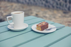 Coffee and cake on table outside Stock Photos