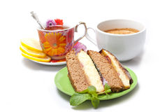Coffee with cake and tea with lemon Royalty Free Stock Photography
