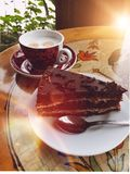 Coffee and cake. Time for a cup of coffee and a chocolate dessert stock photography