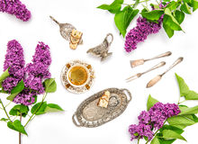 Coffee cake vintage dishes. Lilac flowers Flat lay Stock Photo