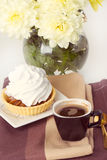 Coffee and cake with whipped cream Stock Images