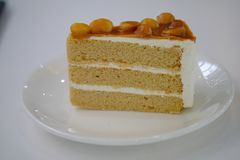 Coffee cake on white dish. Close up Coffee cake on white dish look delicious stock image