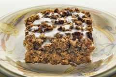 Coffee cake with white frosting. Abuttermilk pecan coffee cake with white frosting on plate Royalty Free Stock Photos