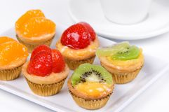 Coffee and cakes. With fruits Royalty Free Stock Images