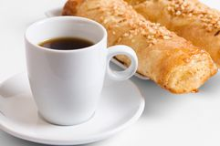 Coffee and cakes. Close off a two cakes and a cup coffee Royalty Free Stock Photography