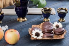 Coffee with cakes and apples Stock Image