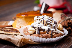 Coffee cakes with chocolate, spices and coffee seeds, close up Royalty Free Stock Photo