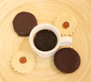 Coffee and cakes. On a wooden plate stock image