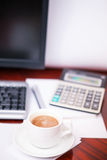 Coffee and the calculator Royalty Free Stock Image