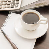 Coffee and the calculator and pen Royalty Free Stock Photography